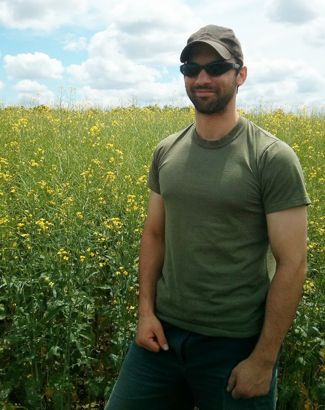 Iain in front of canola
